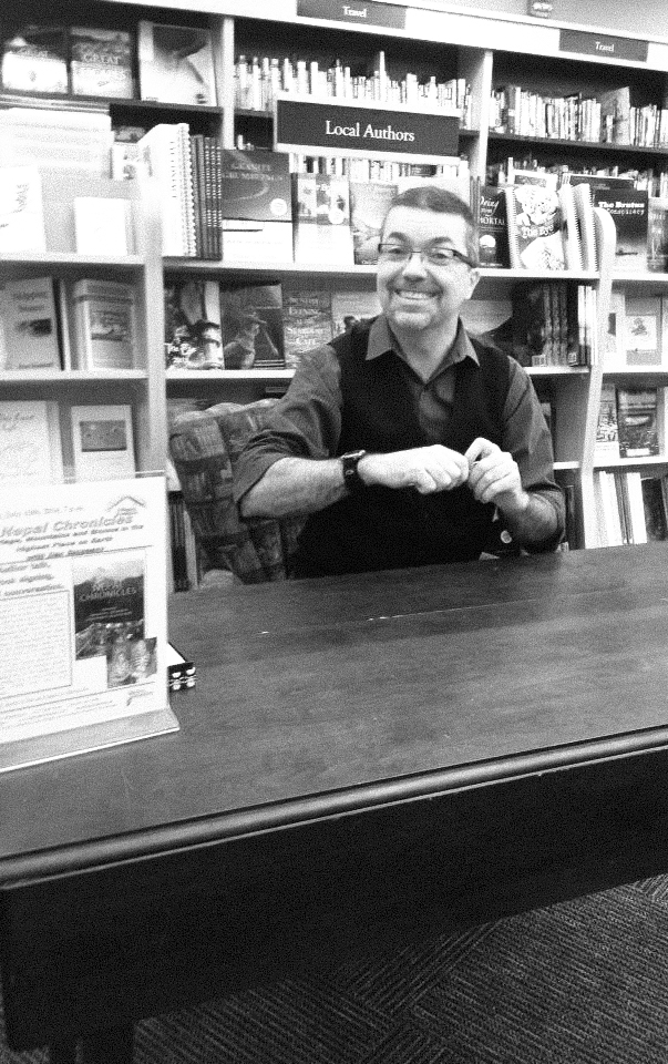 The author sitting at a bookstore table