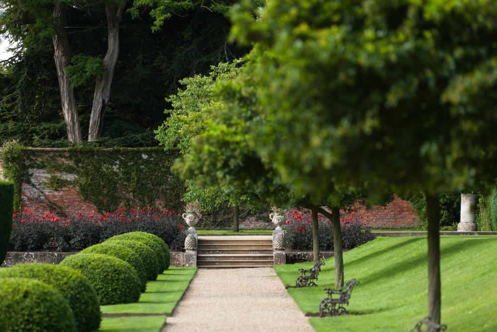 Topiary-lined path in the Italian Garden at Belton House, Lincolnshire.