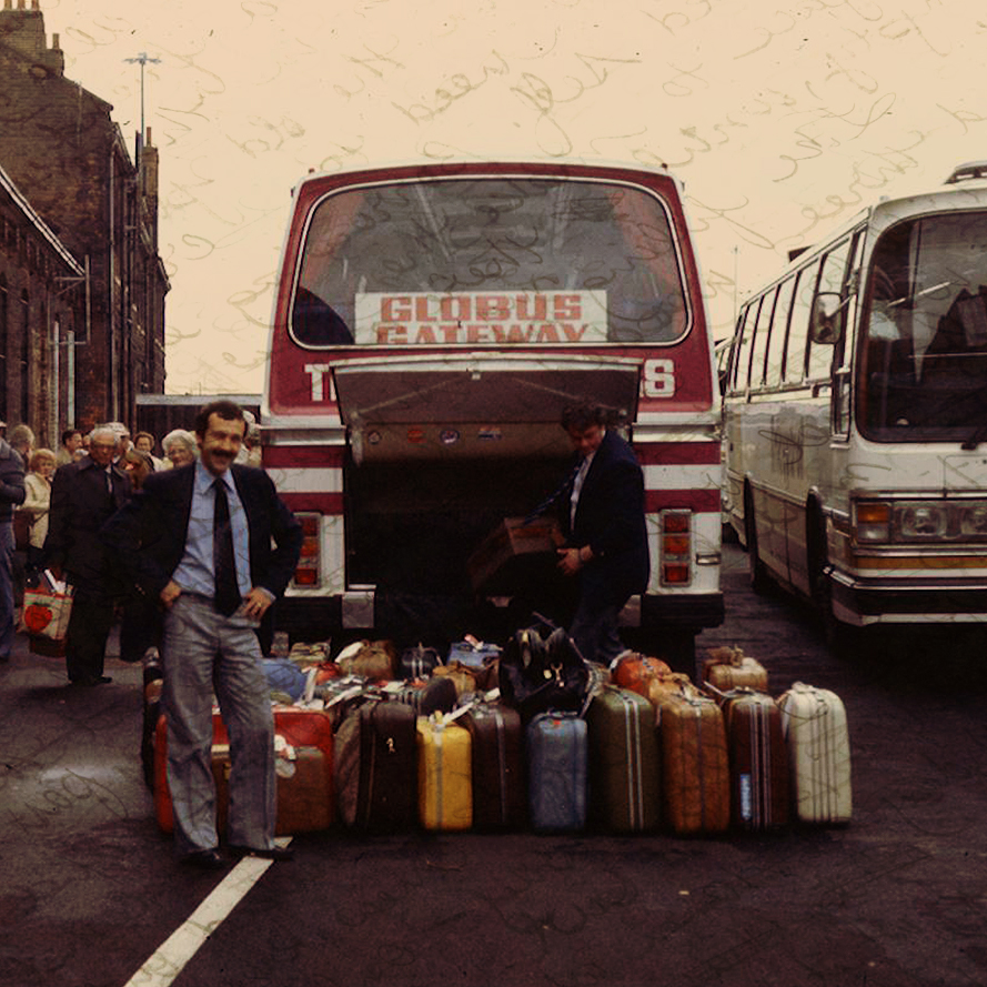 Guide and luggage in front of 1970s UK tour bus