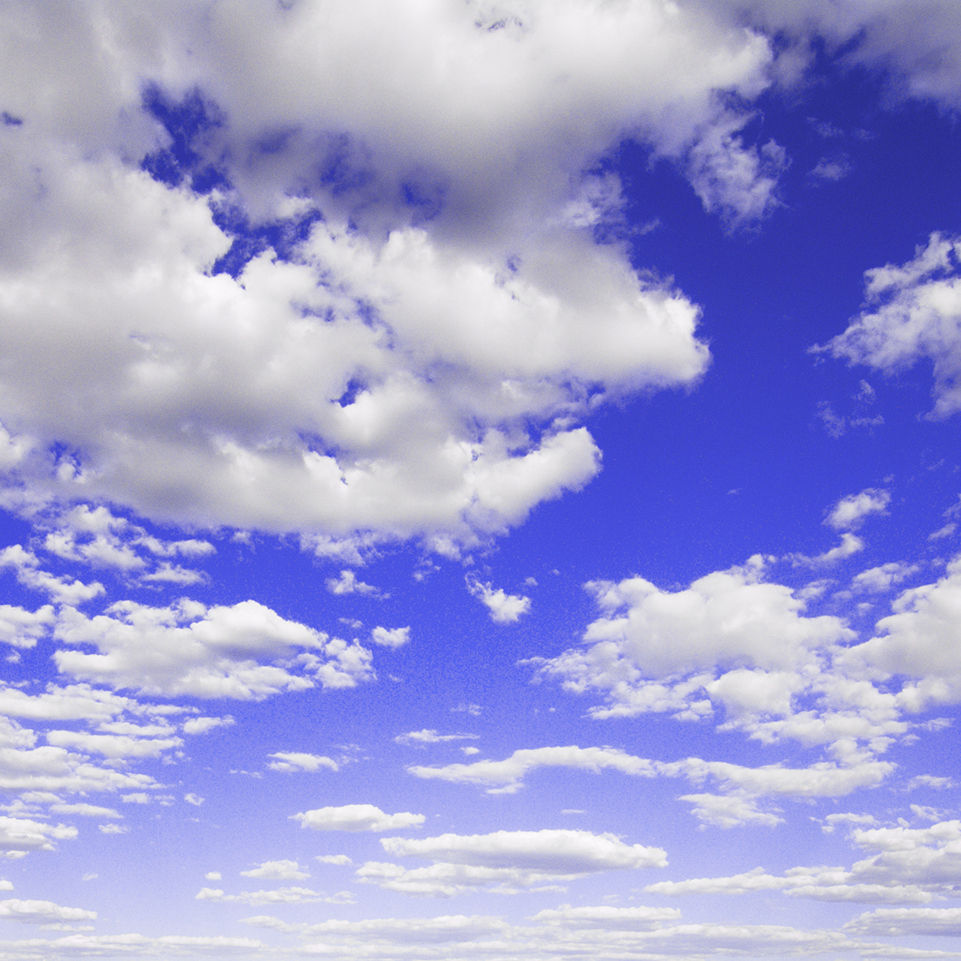puffy clouds in a bright blue sky