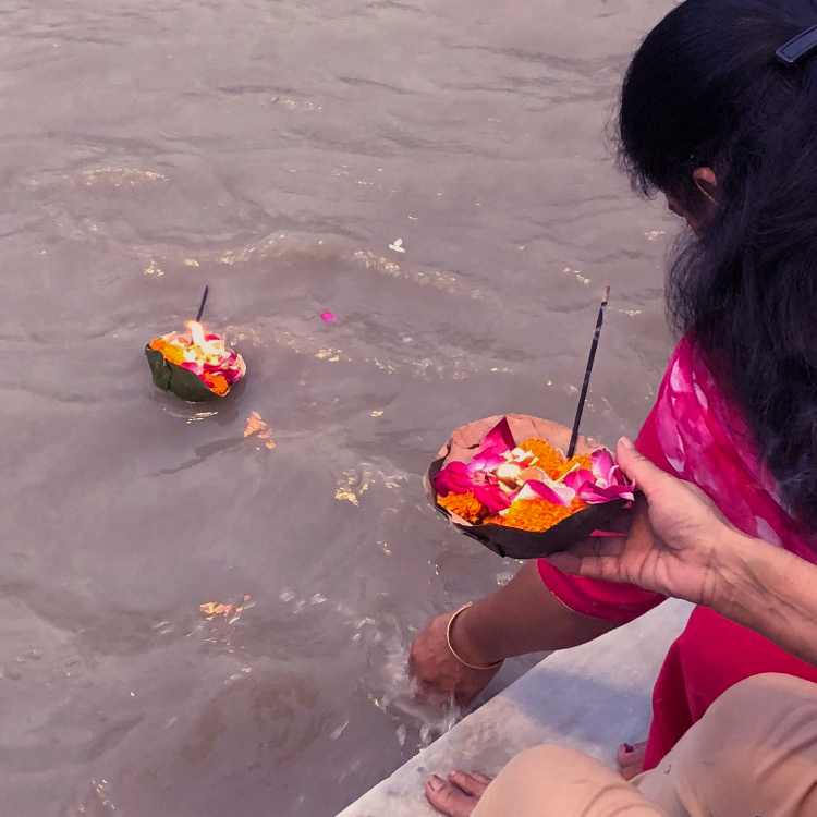 flower offering placed in the River Ganges