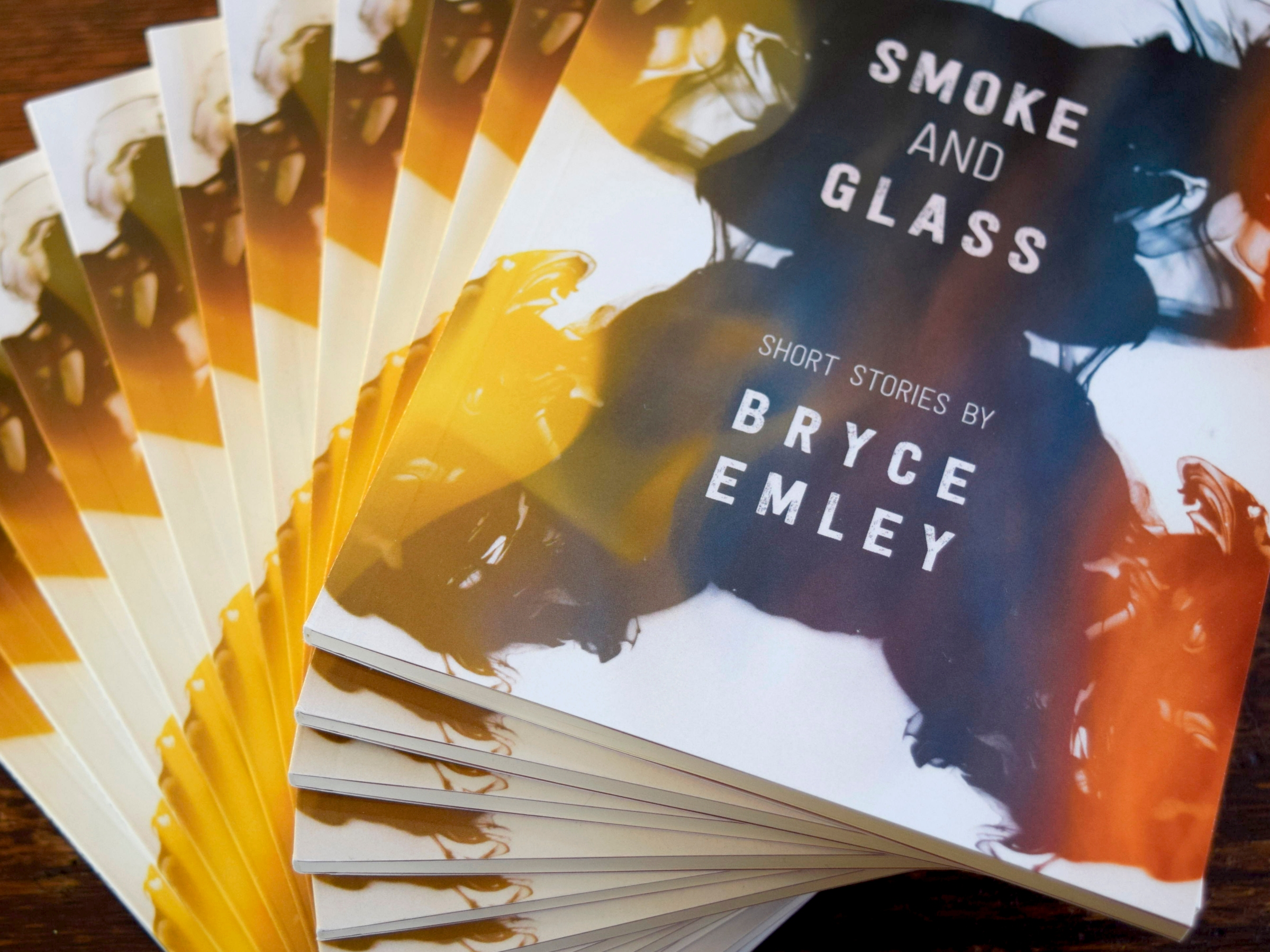 swirled stack of Smoke and Glass copies