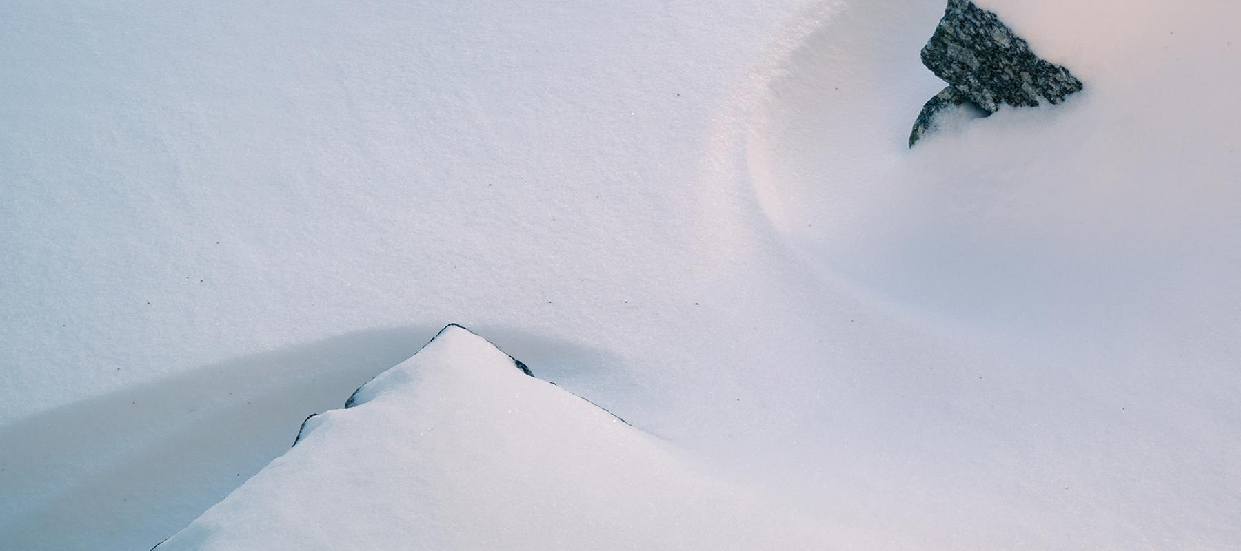 snow filling stone steps